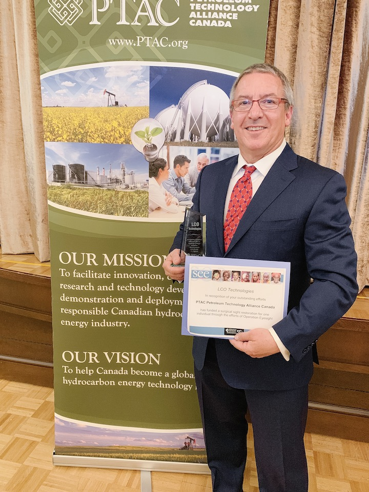 Photograph of Steve Froehler holding LCO's 2018 Commercialization of SME Technology award